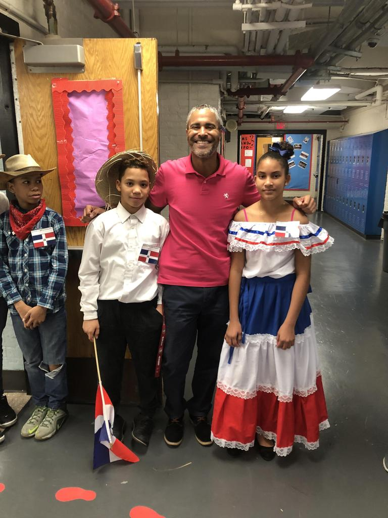 Dean Valera with three dominican students