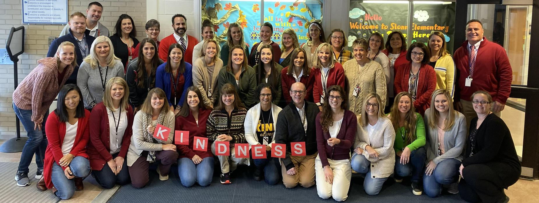 Sloan Elementary School teachers and FR administrators celebrate World Kindness Day by wearing their best Mister Rogers sweaters and cardigans!