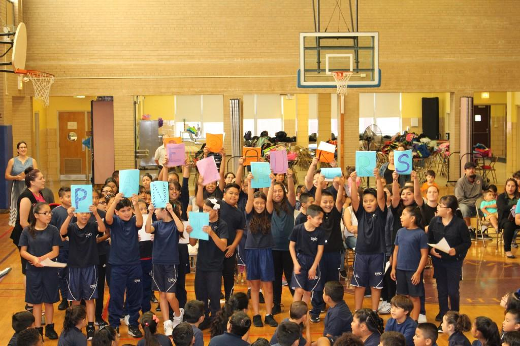5th grade holding up PANTHERS banner