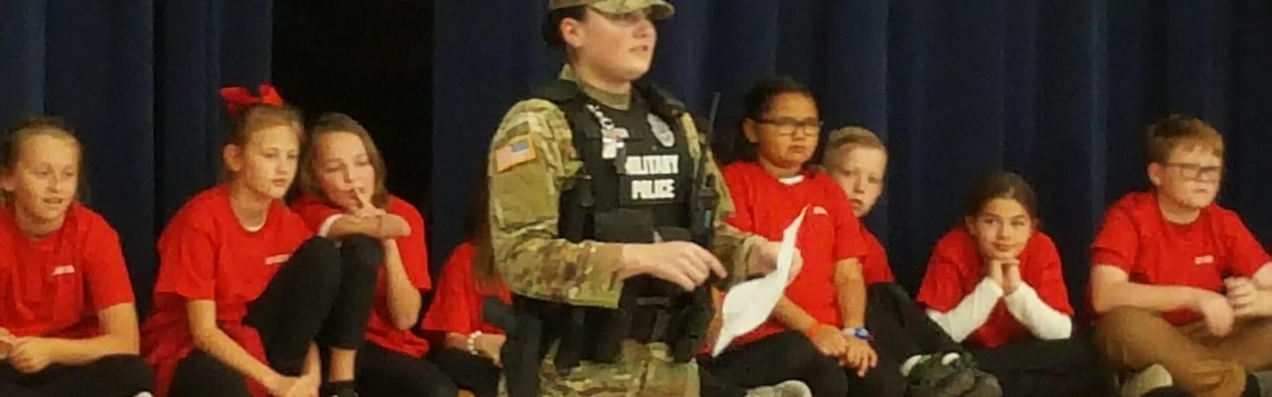 Solider speaking to students