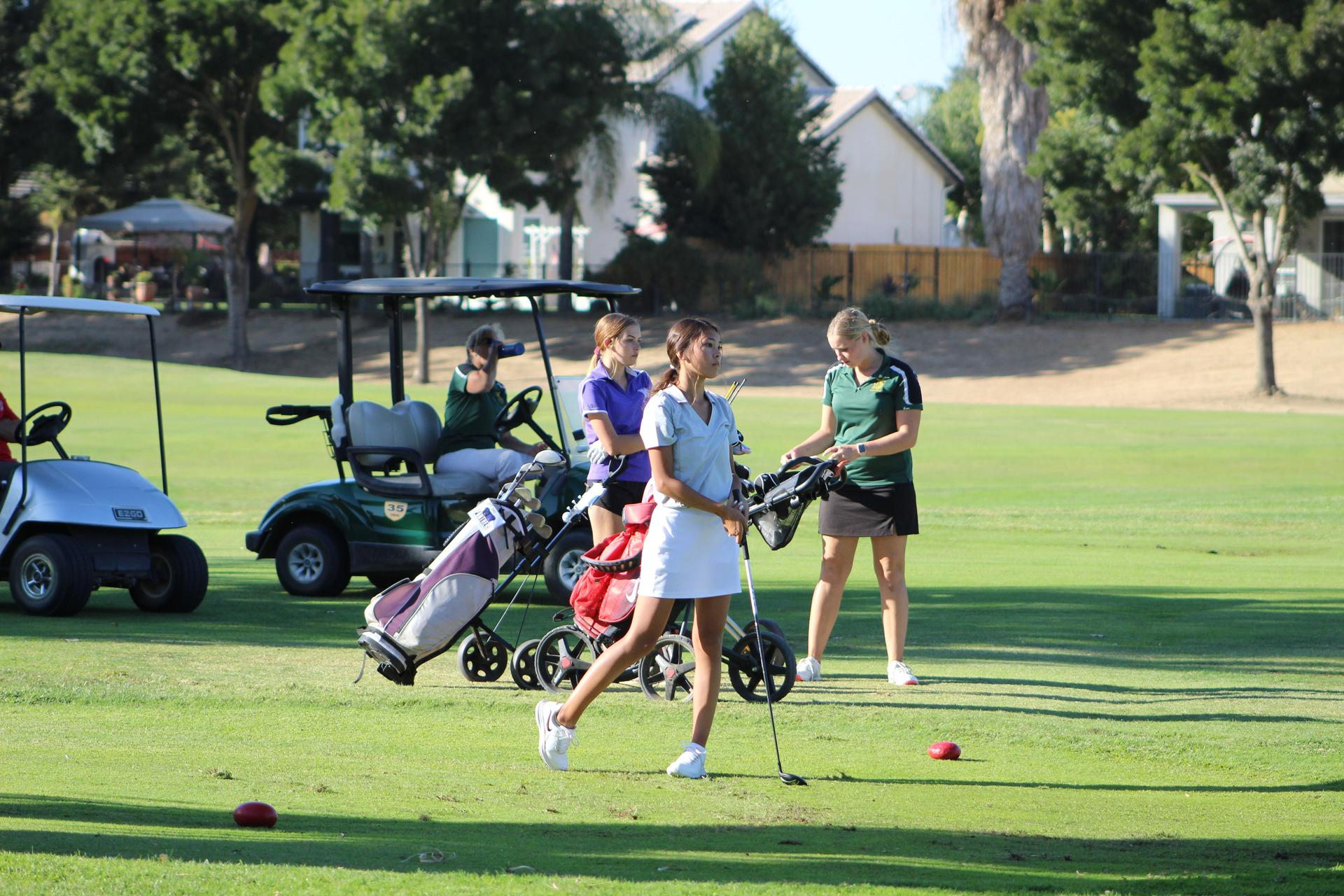 Girls playing golf