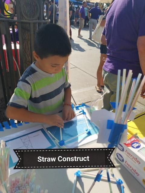 student constructing with straws