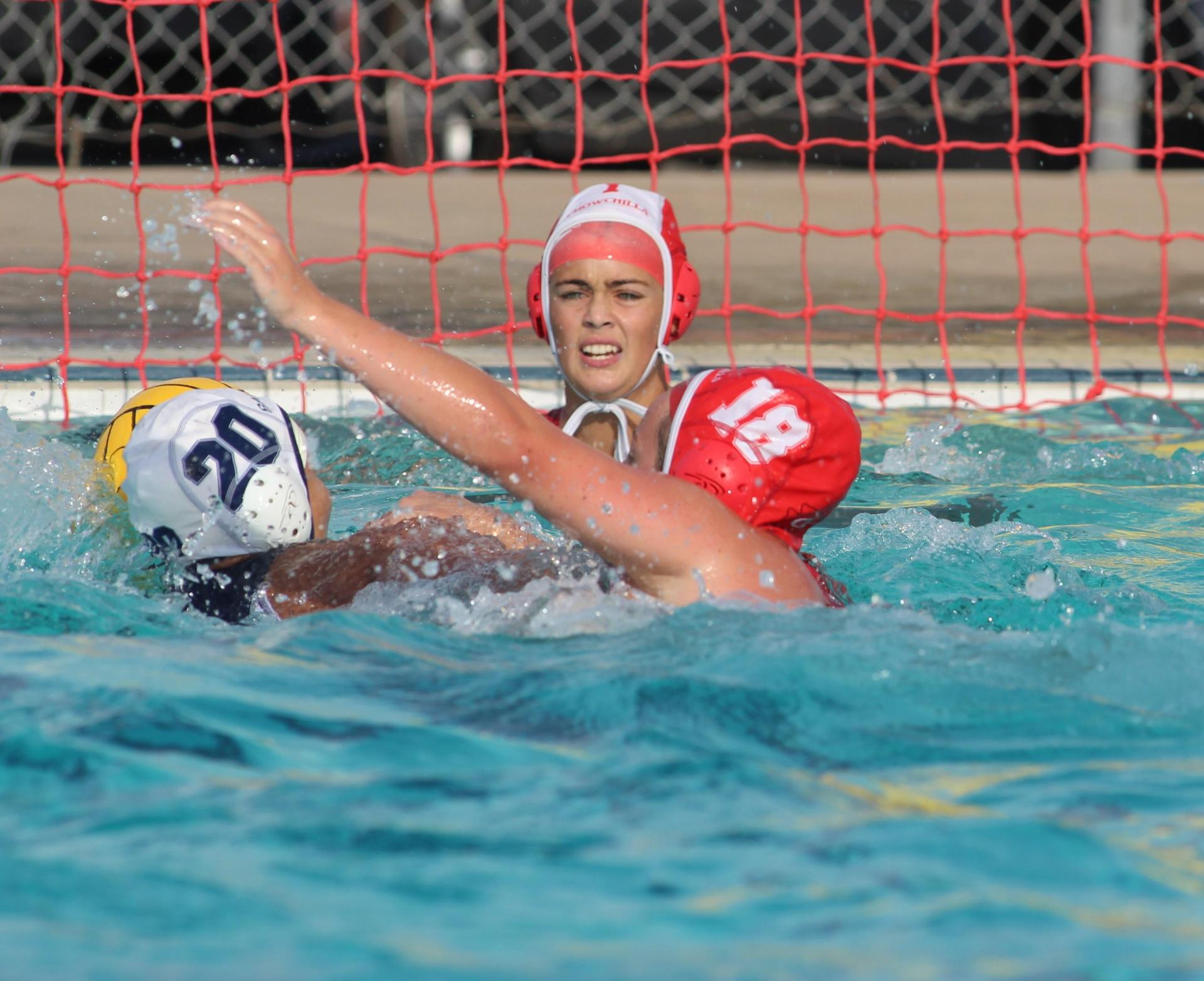 Girls playing water polo against Yosemite.