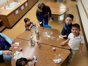 Childrenat table with Oobleck
