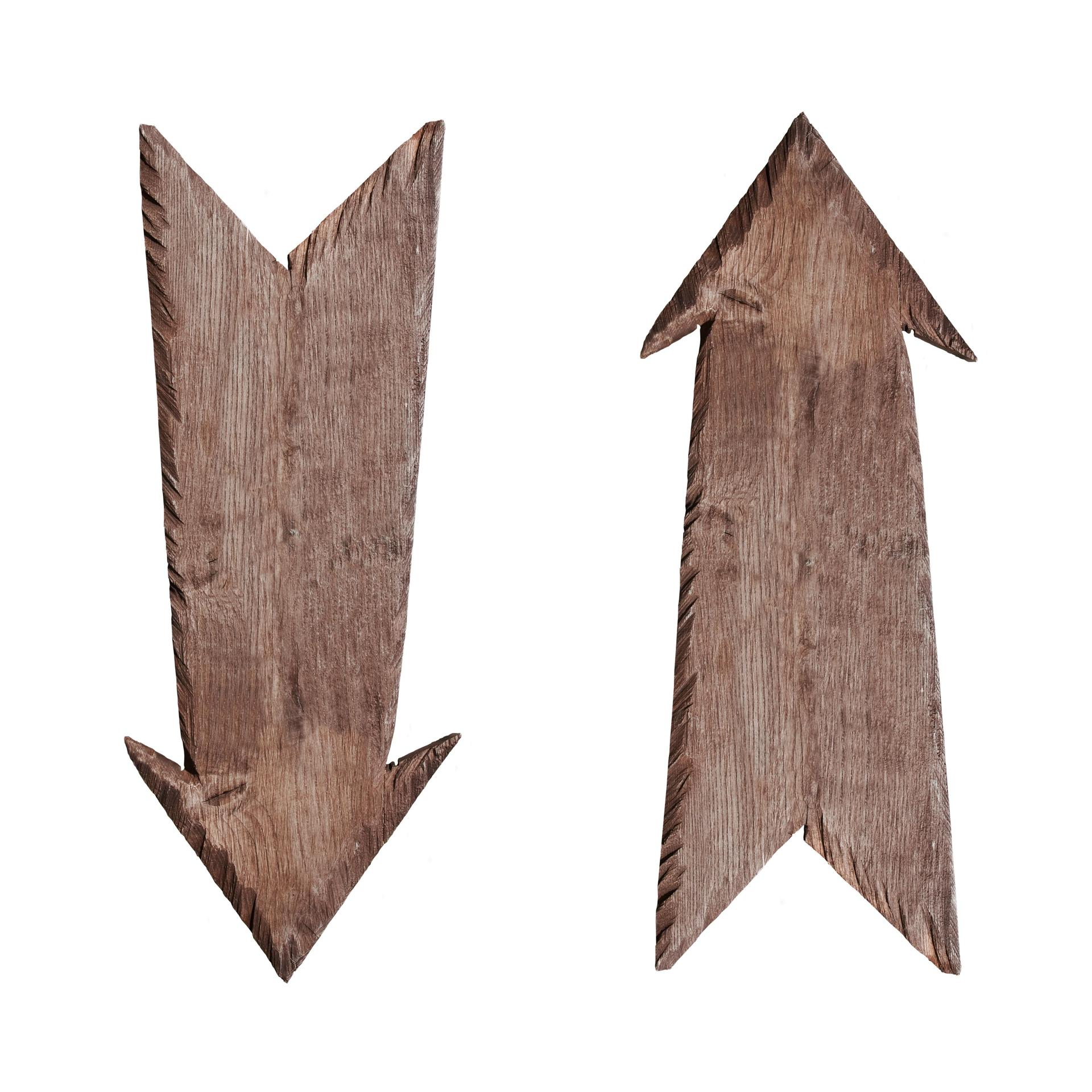 Wooden arrows pointing in opposite directions