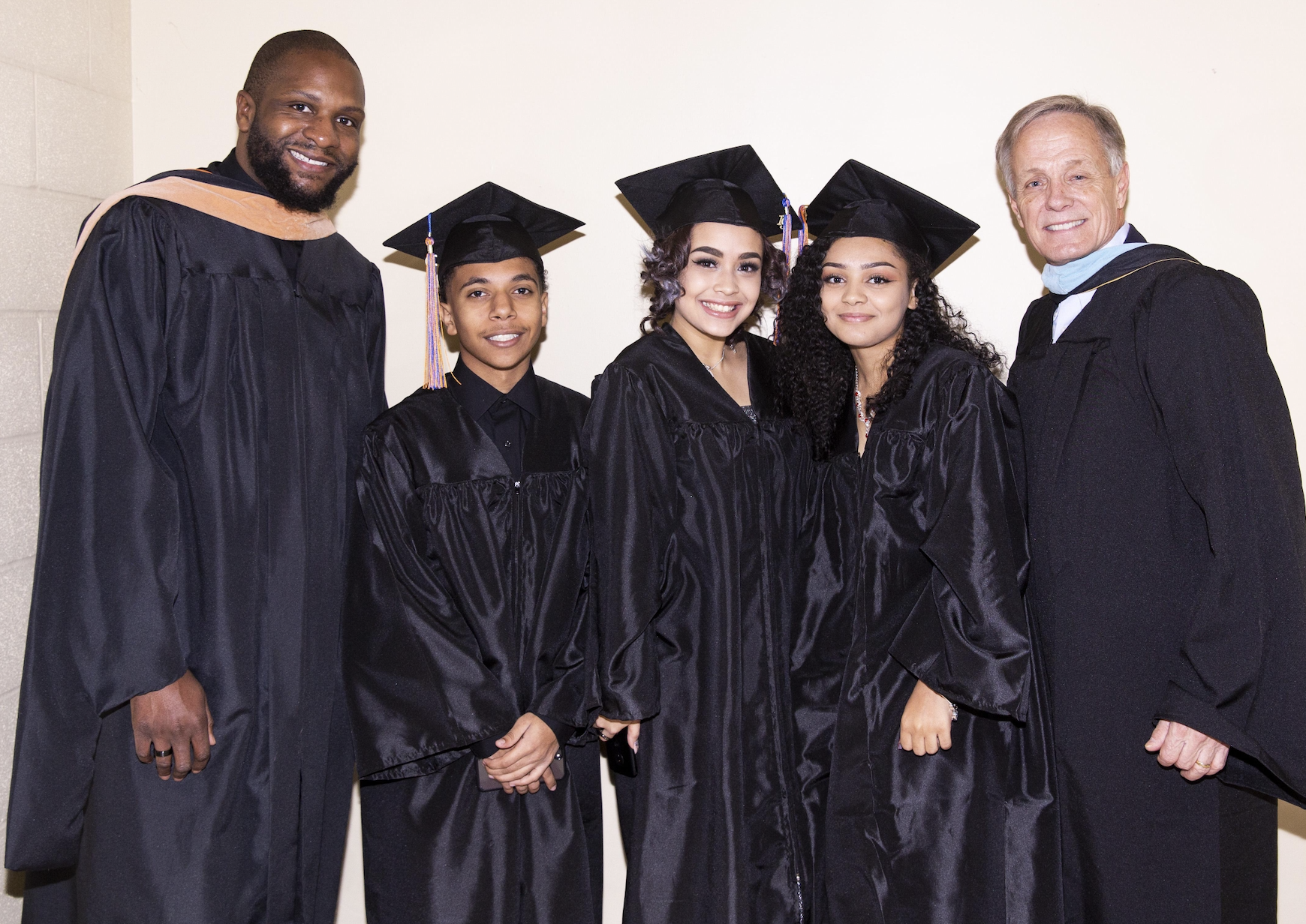 Graduates with Mr. Garth and Woods