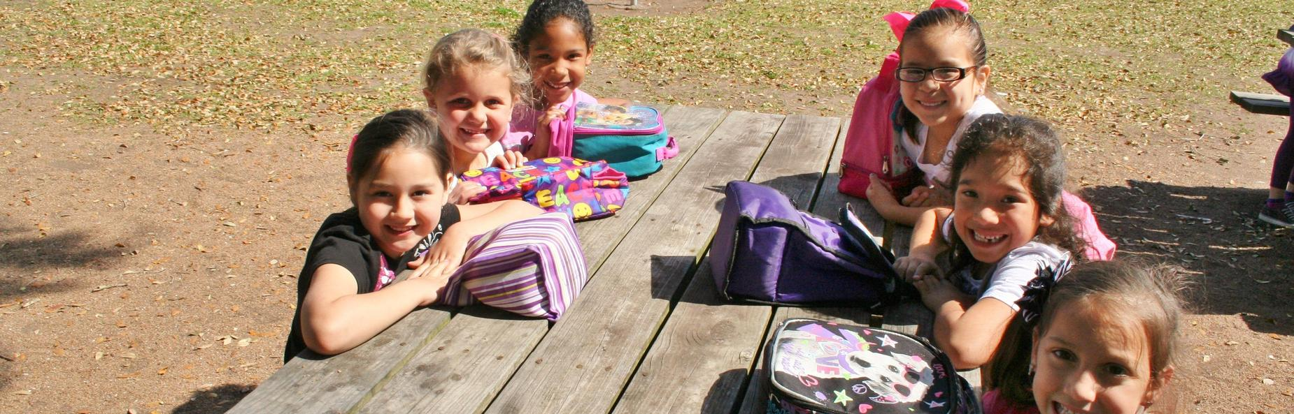 children at a picnic table