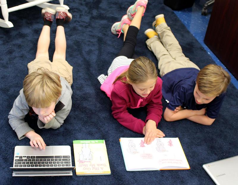 Second graders studying