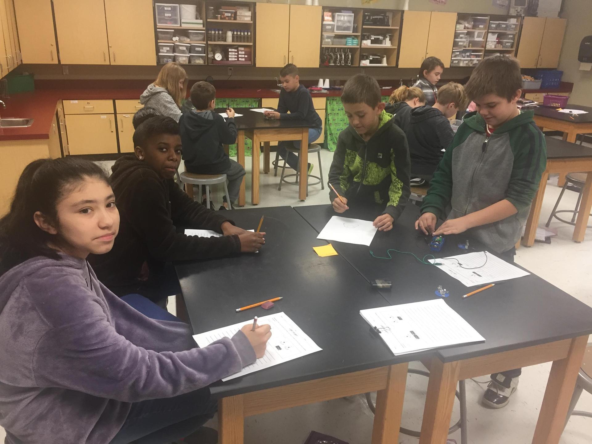 students testing increased energy source