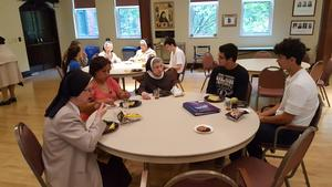 photo of students with Sisters at a table