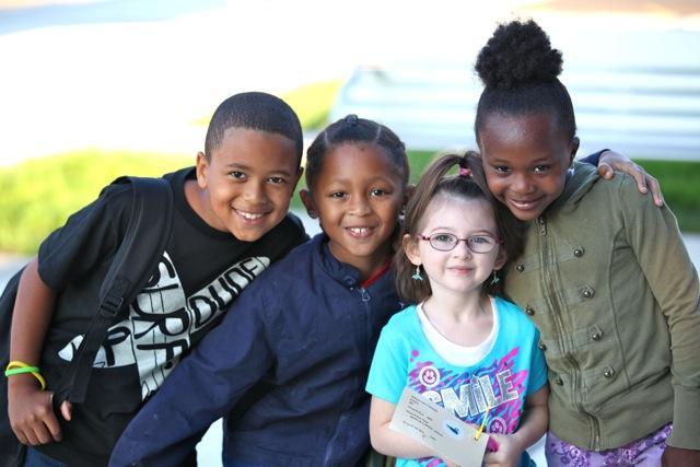 group of kids smiling at camera