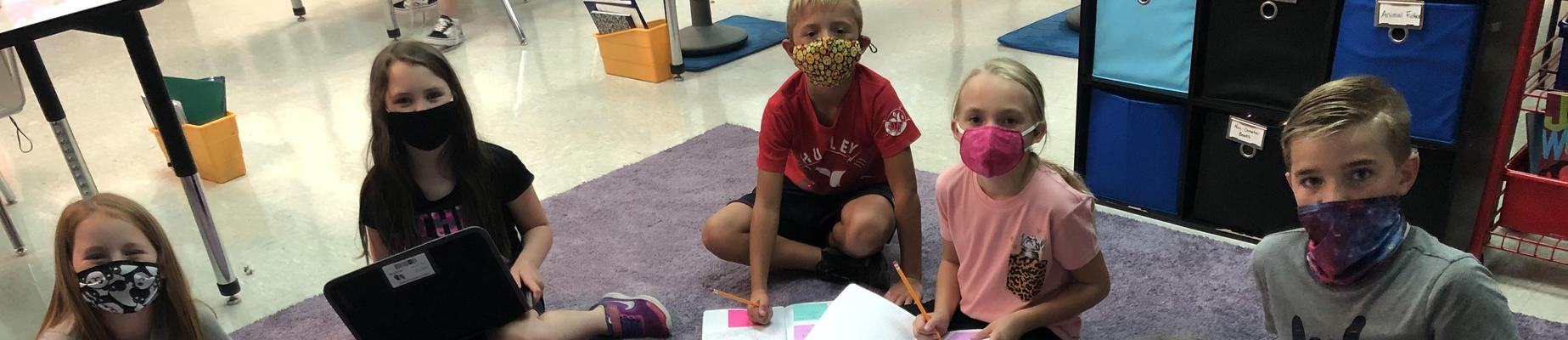 Kids learning on carpet