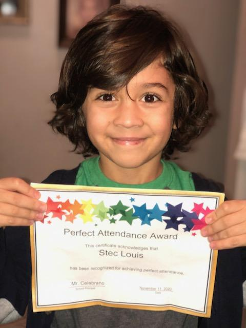 Louis Stec holding perfect attendance certificate