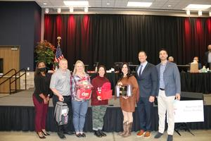 January Teacher of the Month, Magnolia West High School's Nieves Woodward, is honored at the January Board Meeting