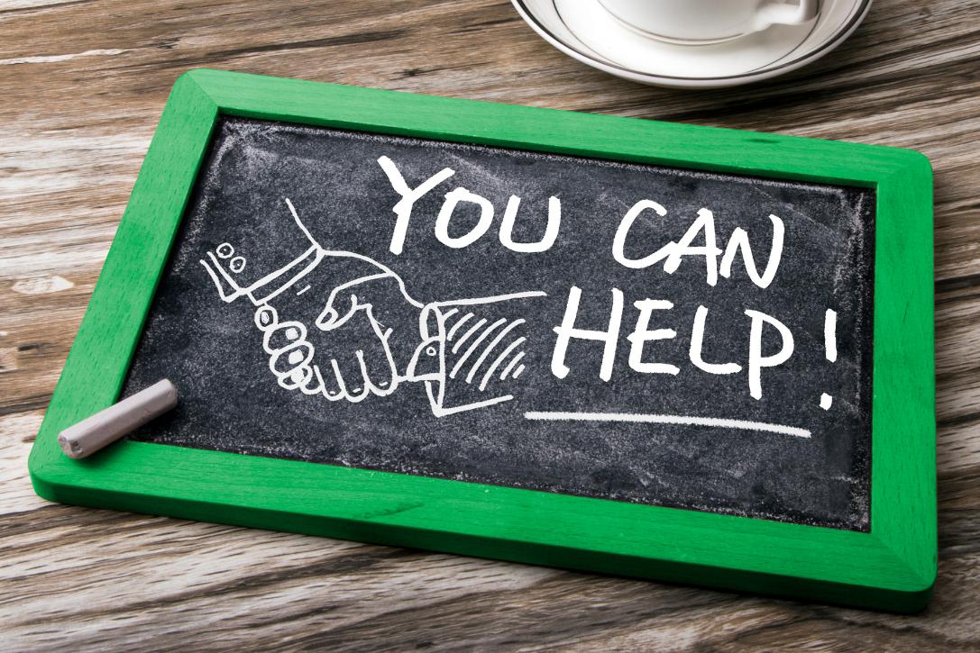 You Can Help and handshake drawn on blackboard
