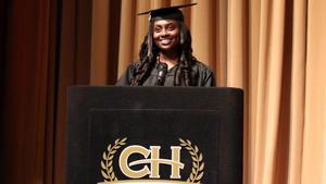 student speaking at graduation