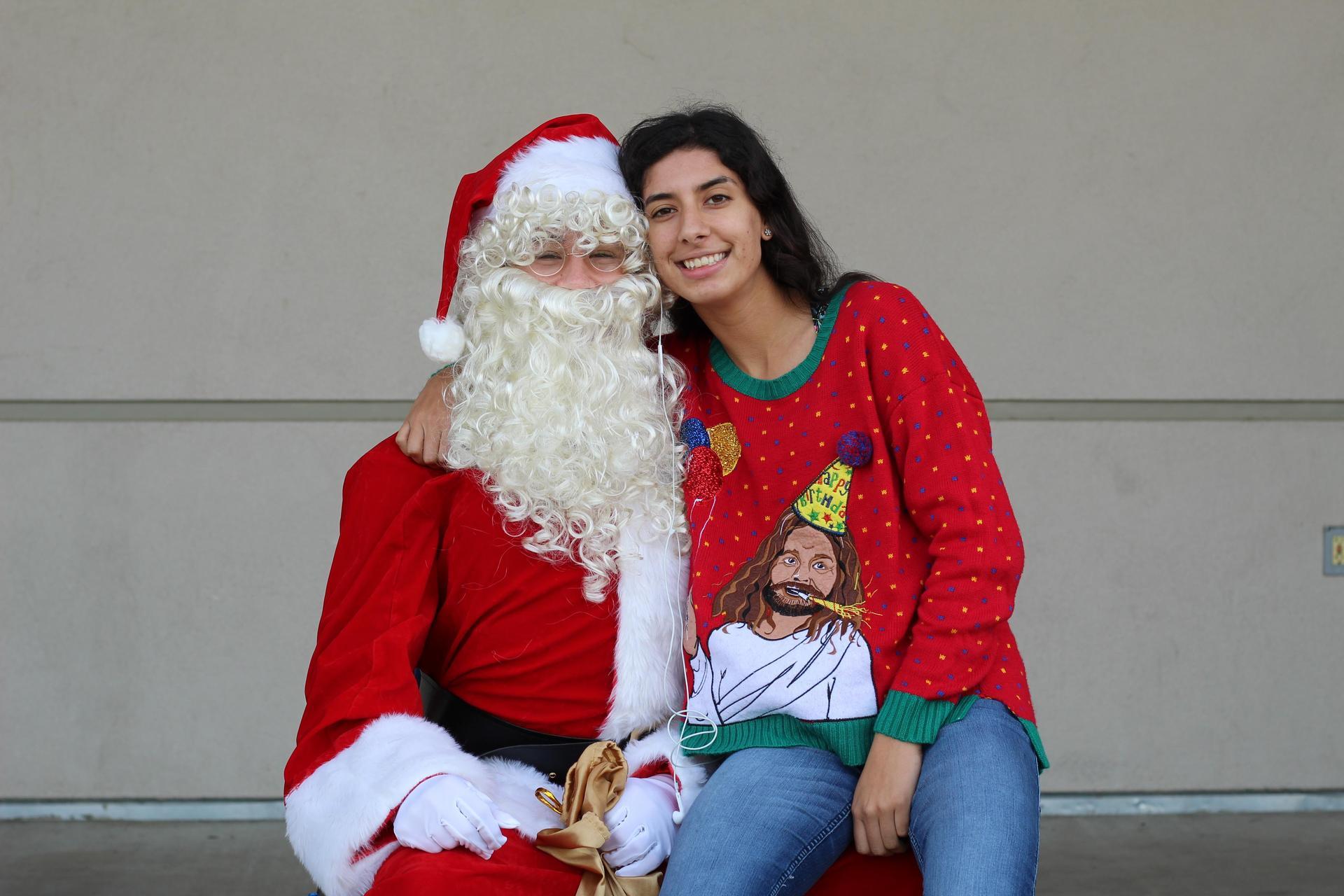 Priscilla Foster sits on Santa's lap