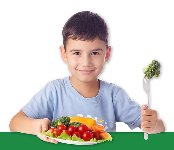 hungry young male student with nutritious salad