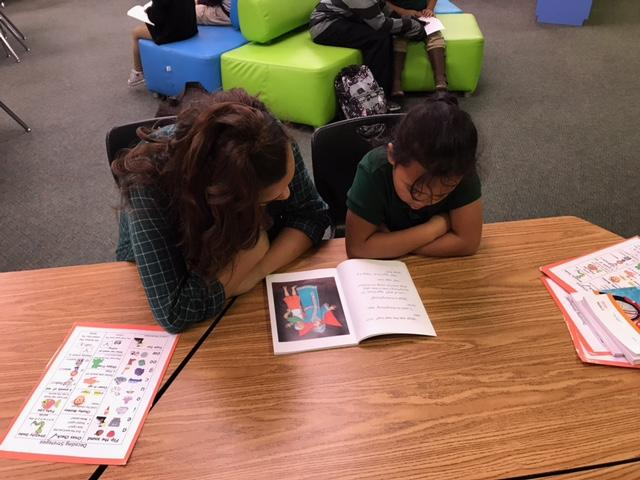 CCA students read with elementary schools in the district.