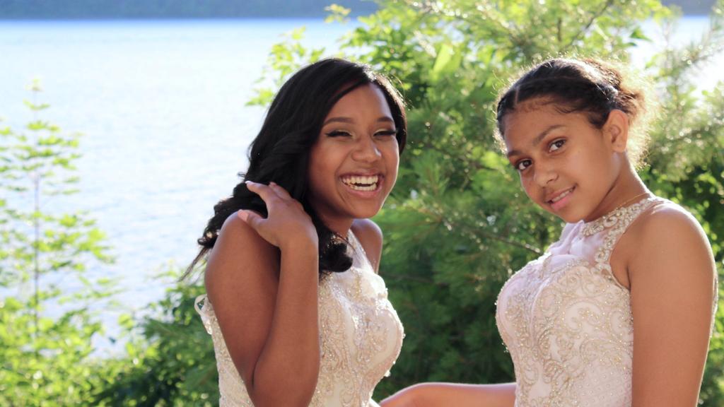 2 girls posing