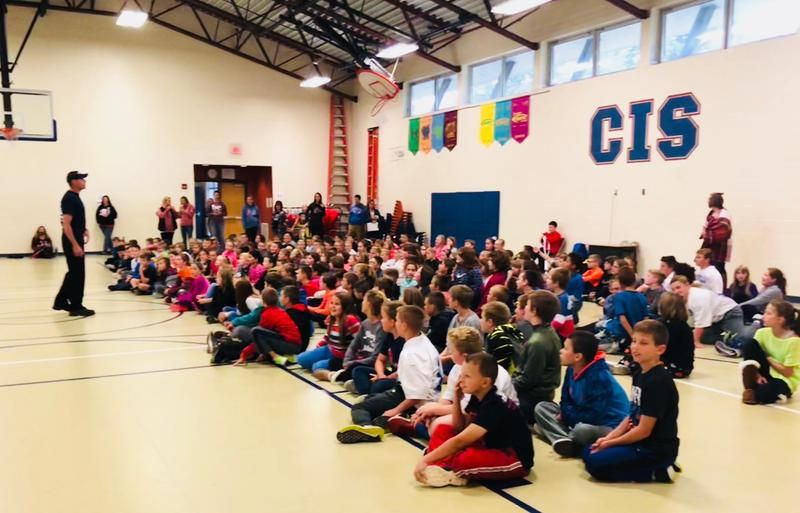 students attend a fire safety assembly