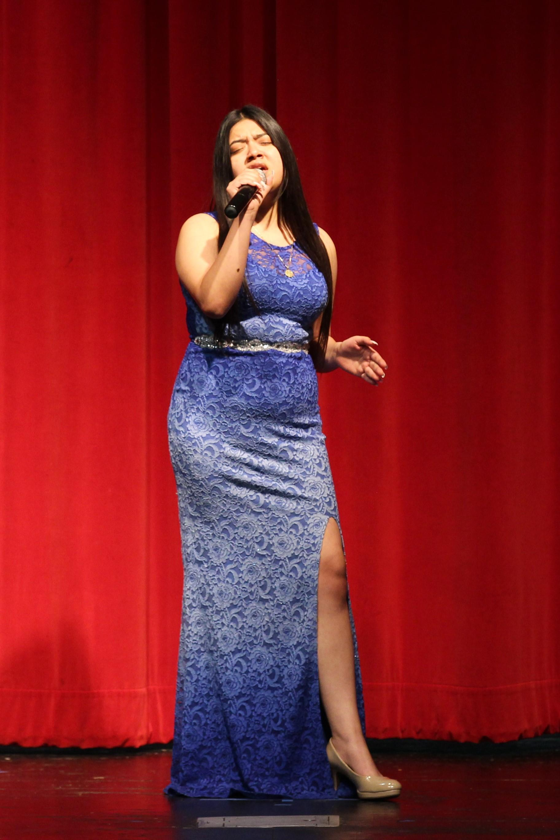 Karla Ceja singing at the talent show