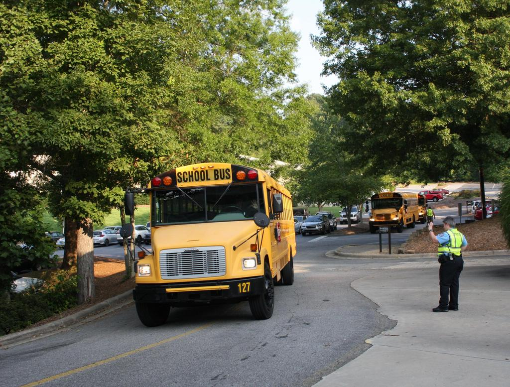 School buses arrive on the first day of school at Wilkes Early College High School.