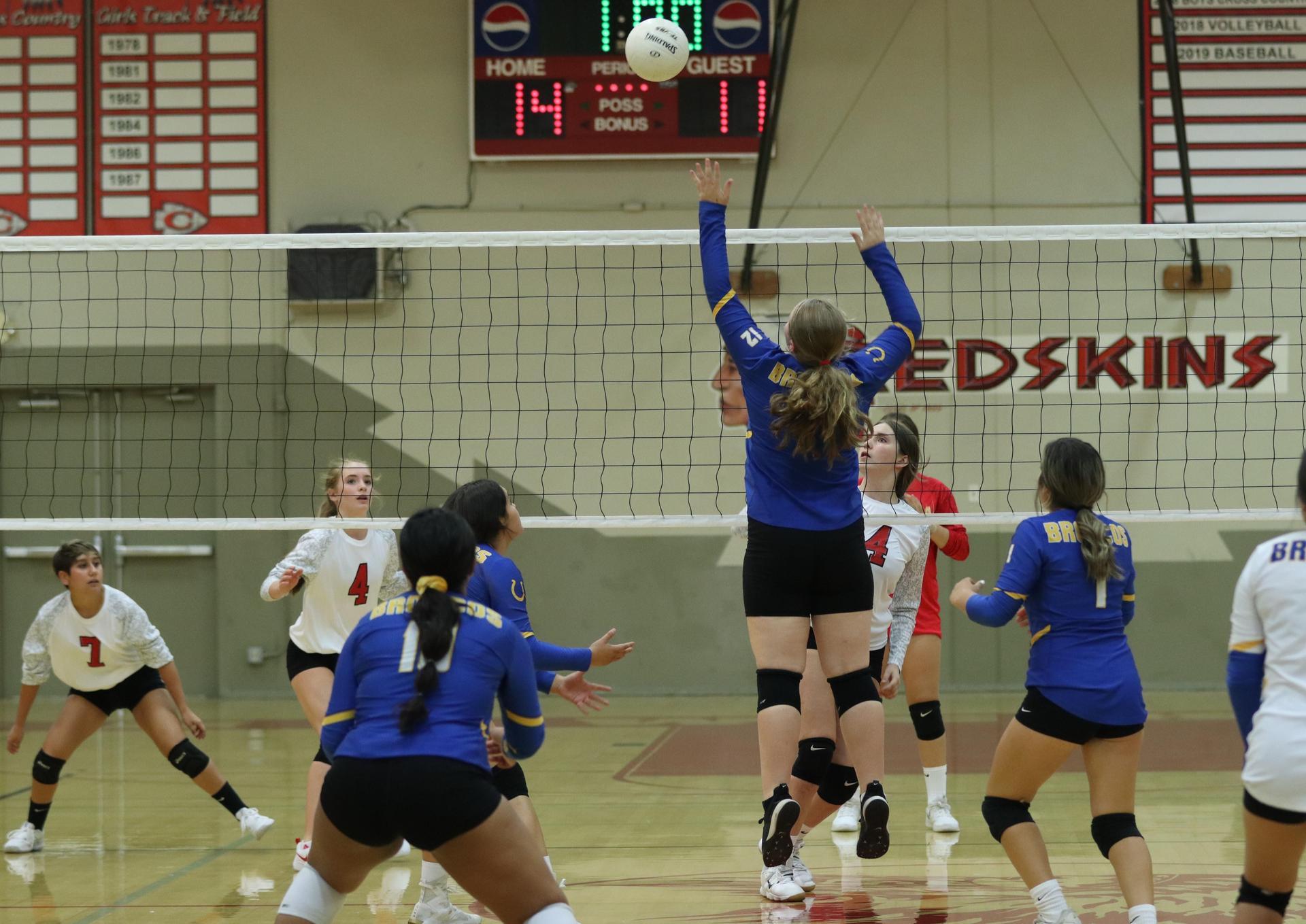 JV girls playing volleyball against Firebaugh