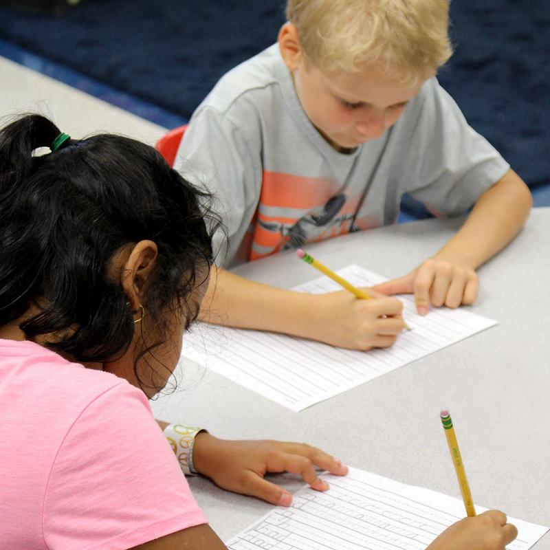 Second graders begin to learn cursive writing.