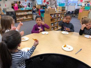 Once a month we have Paula Kerr, a nutrition educator with the SNAP ED. program from the Kent ISD, come and introduce a new fruit or vegetable to our preschoolers. In these picture the children are trying sweet potatoes.