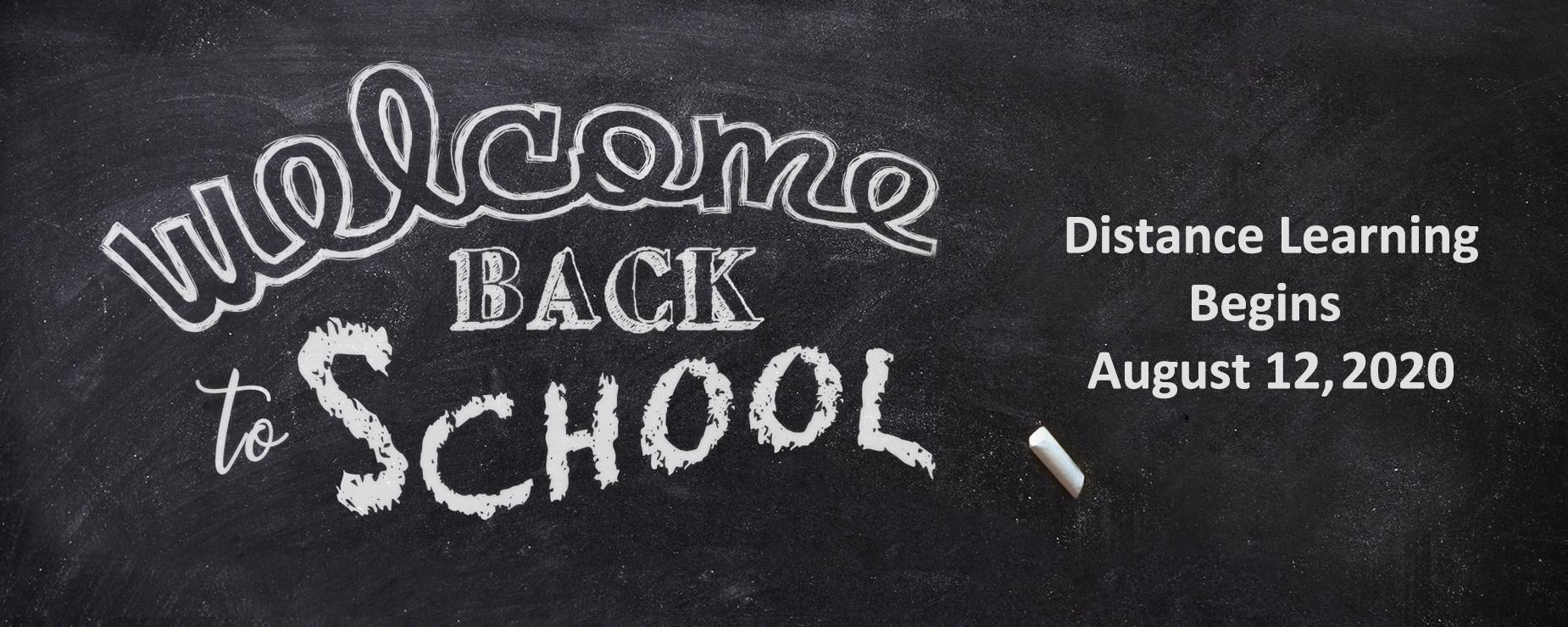 Chalkboard with Welcome Back to School, Distance Learning Begins August 12, 2020 written on it
