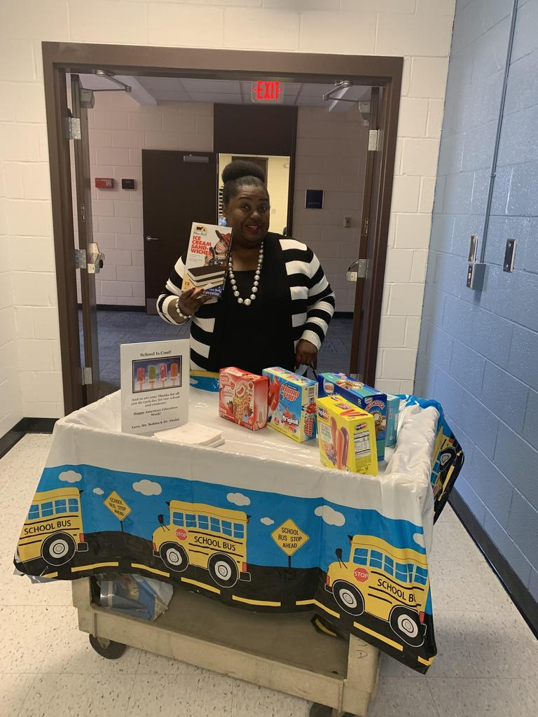 Dr. Tindal passing out goodies to staff and students.