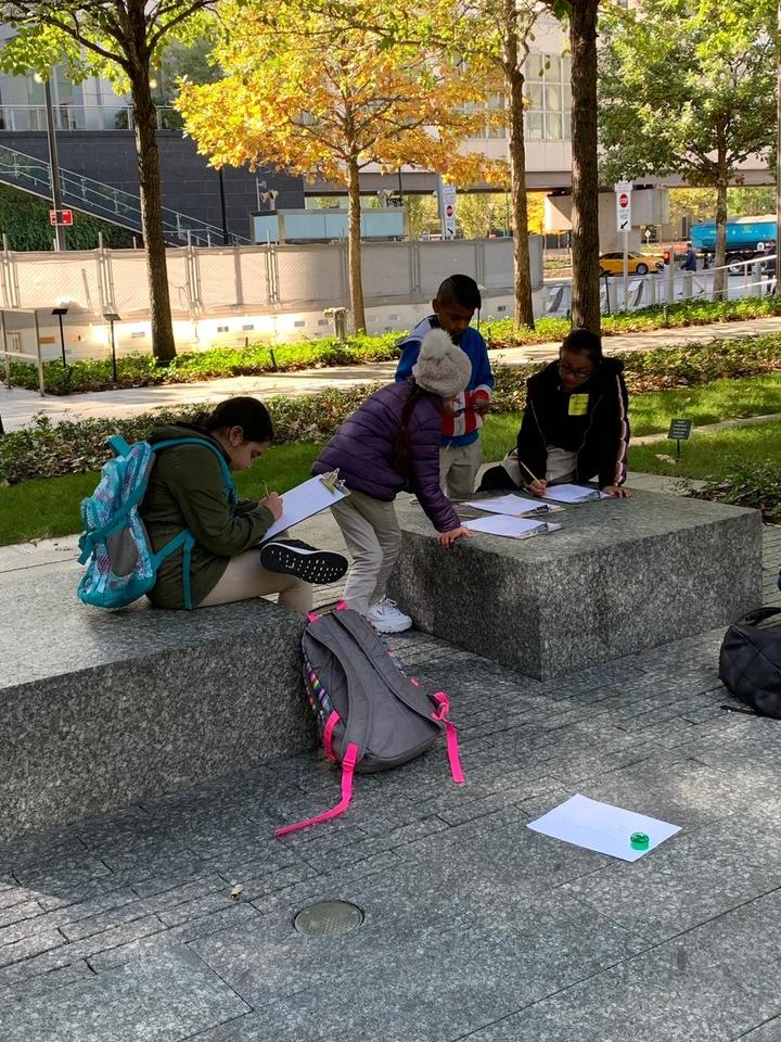 several kids writing their observations