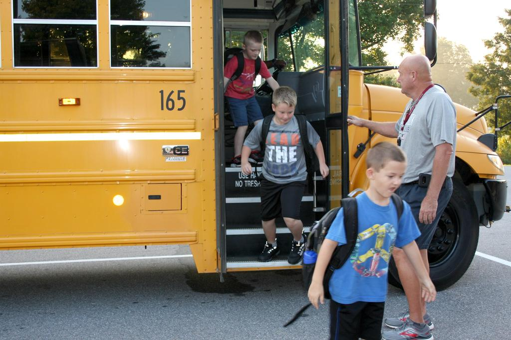 Students unload the school bus for their first day at Mt. Pleasant Elementary.