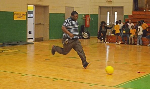 Mr. Griffin plays kickball