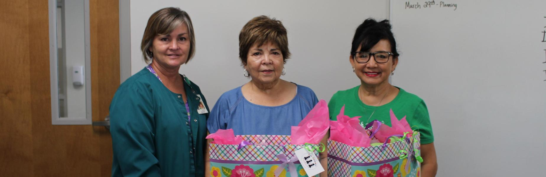 LADIES WITH GIFT BAGS