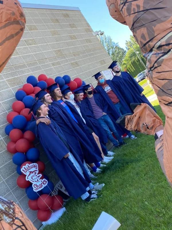 tall boys under ballon arch