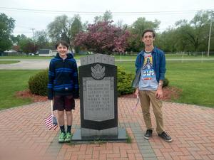 TKMS students continue the tradition of decorating grave sites of veterans with American flags for Memorial Day.