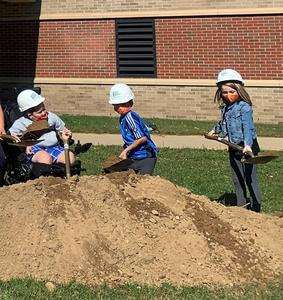 Lee students take the first shovels full of dirt.