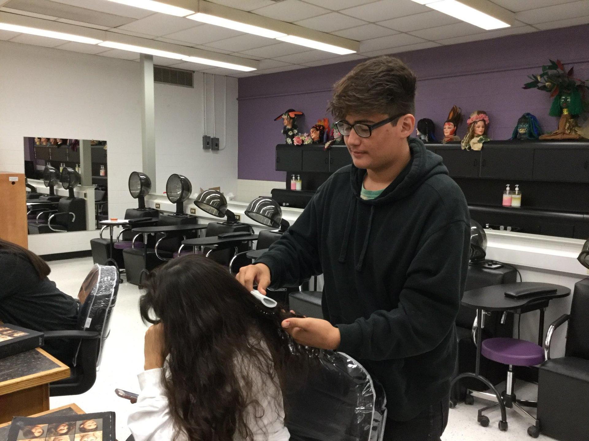 student styling another student's hair