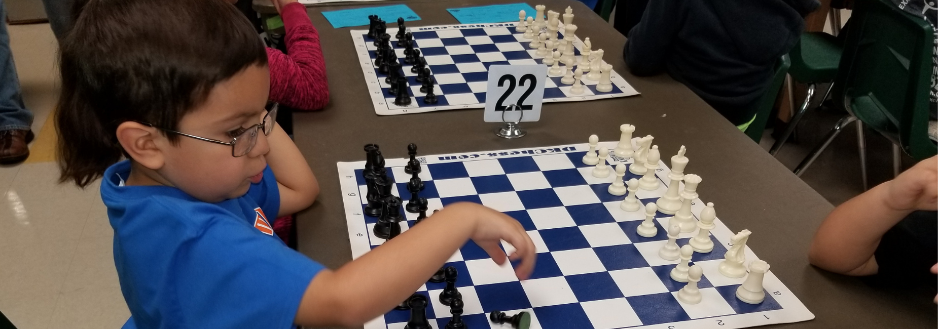 Kinder chess player at first tournament.