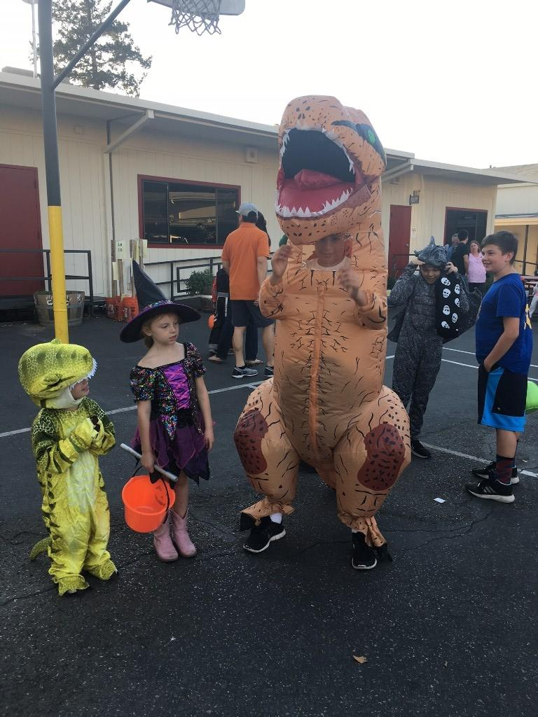 two children dressed as dinosaurs