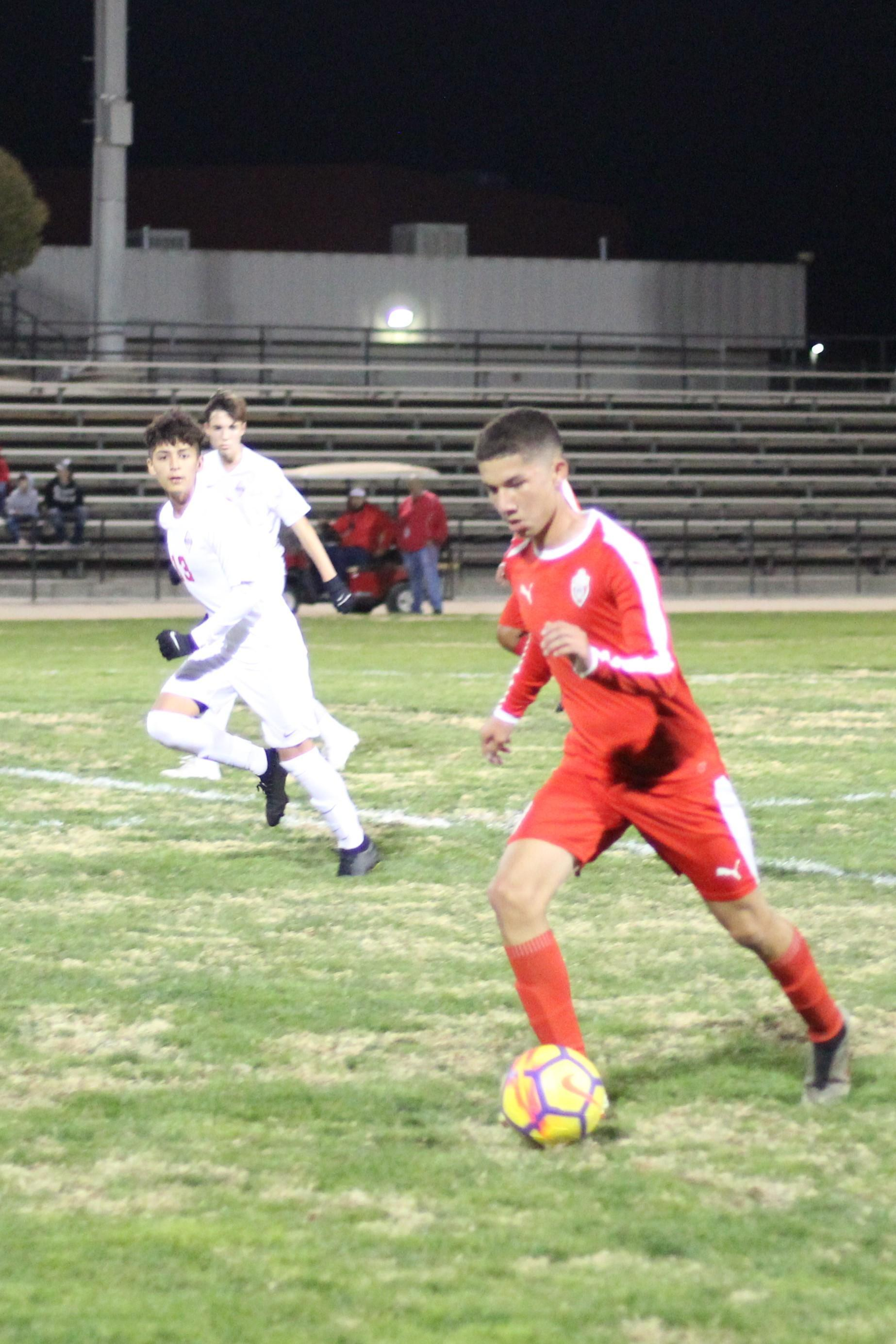 Jose Renteria running the ball down the field