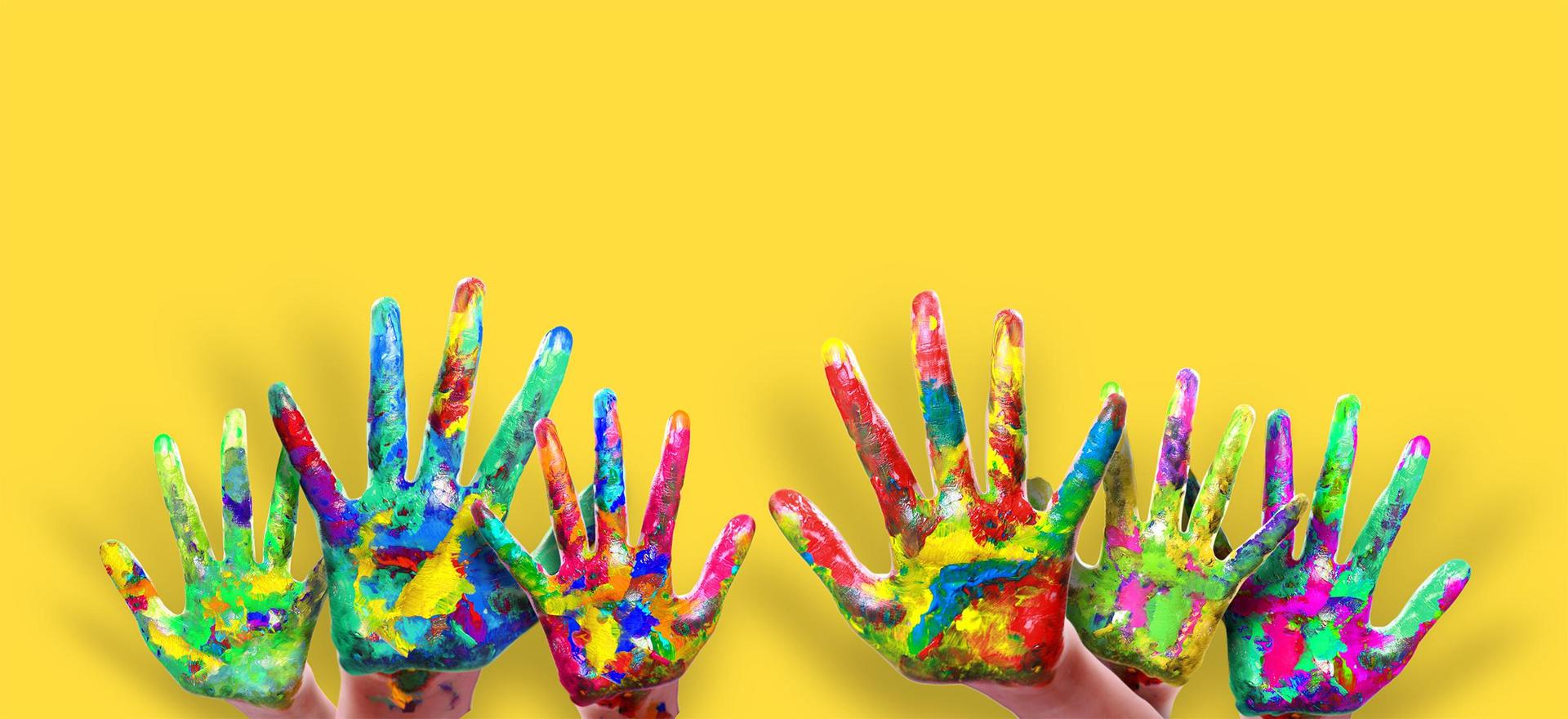 Hands covered in colorful paint colors