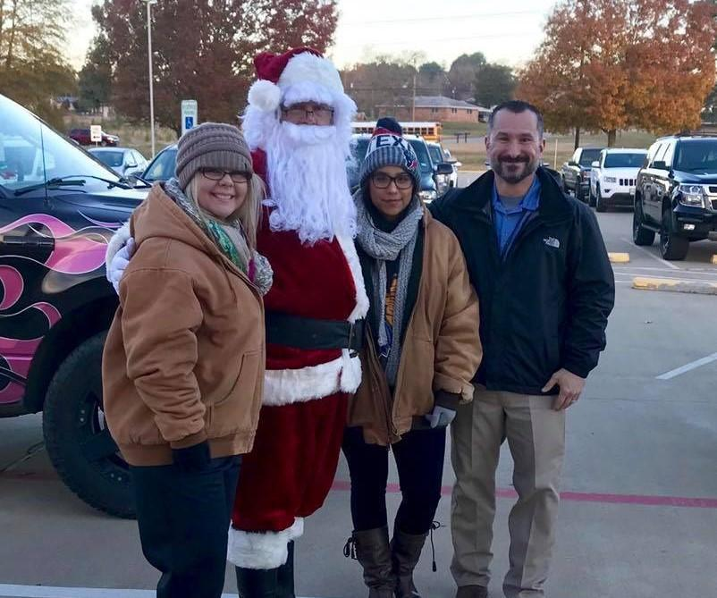 staff standing with Santa in car rider line