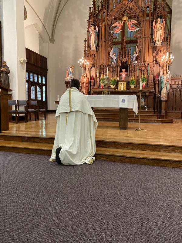 Fr. Bill Dorner in the OLSH Chapel with the Blessed Sacrament