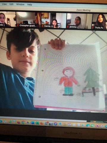 Boy holding up drawing on zoom
