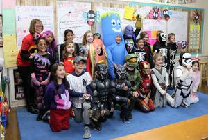 :  McKinley 2nd graders in Kathleen Speir's class pose for a class photograph during a Halloween party on Oct. 31.