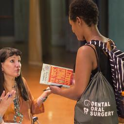 student getting book signing