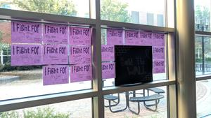 Papers hang on the windows of OHS saying